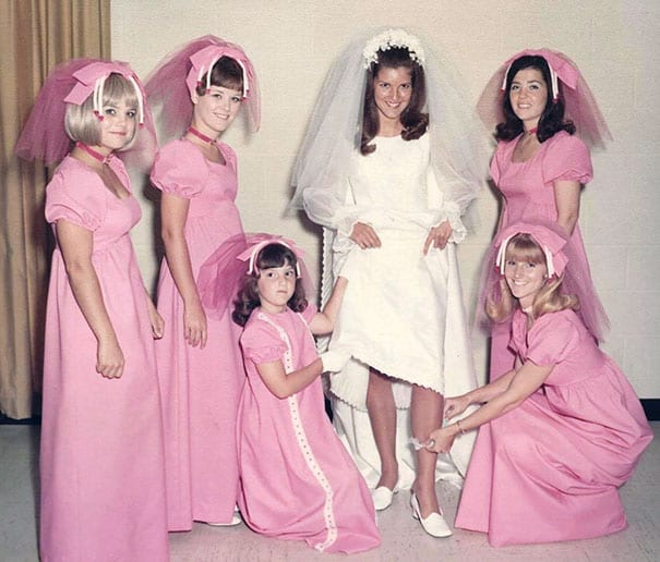 3a2325e29e Their matching pink headpieces with a bow and strange tentacles hanging  down are not the most common bridesmaid accessory that you would see at  most ...