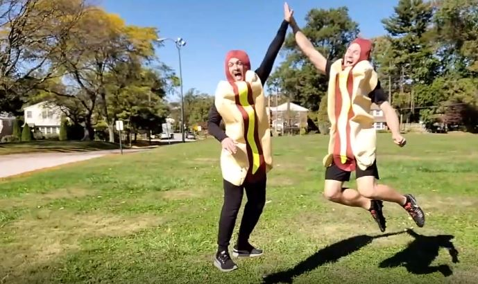 The two brothers dressed in hot dog costumes