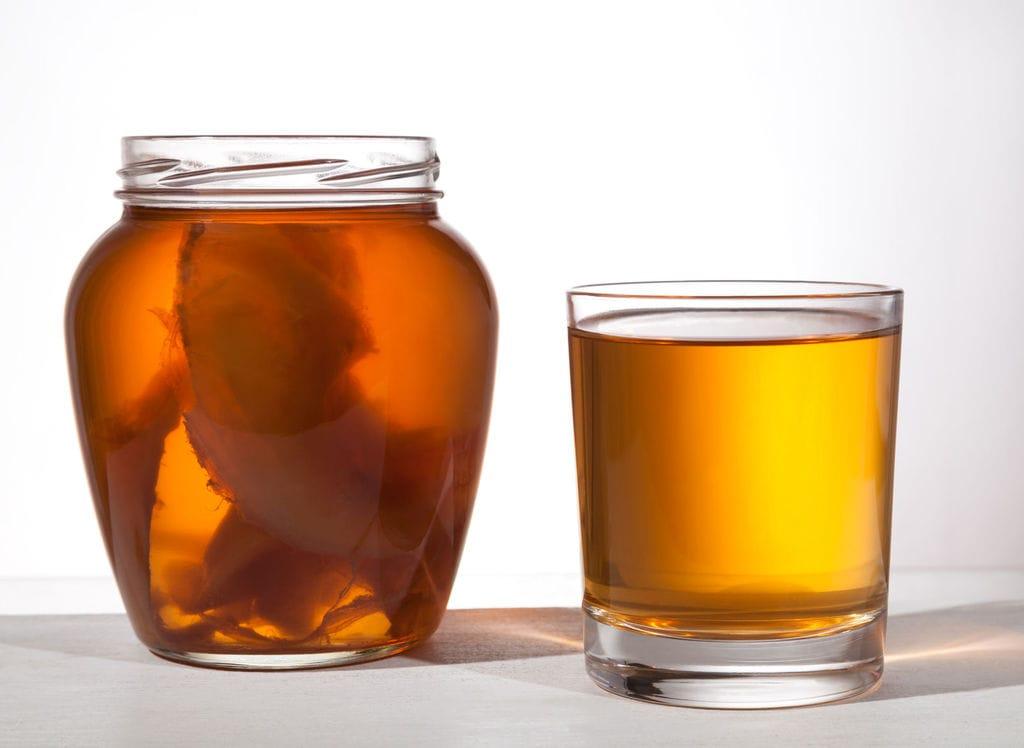 a glass of kombucha
