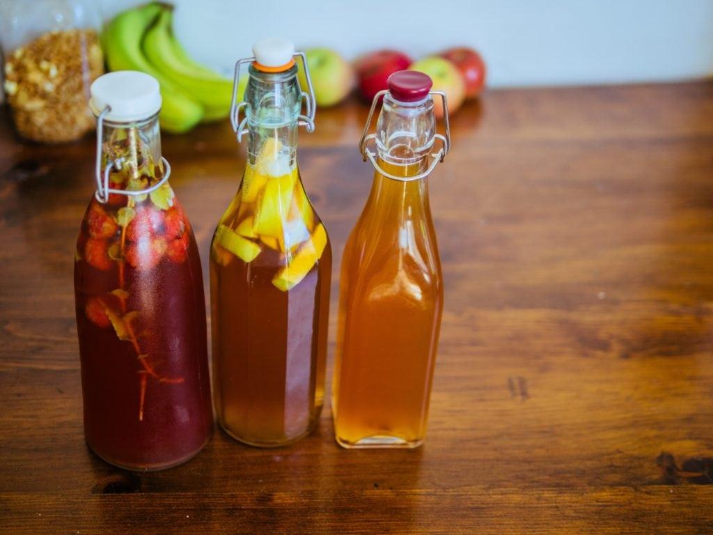three glass bottles of kombucha drinks