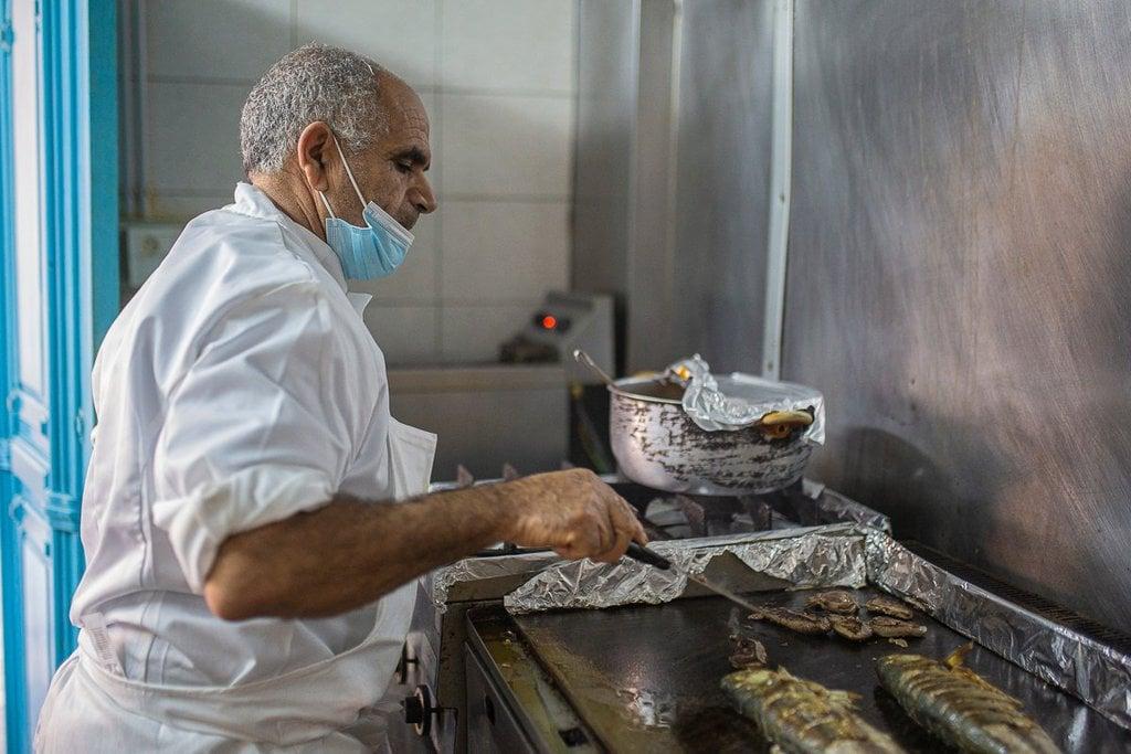 Lasaad Nawaili cooking fish in his Zarzis restaurant