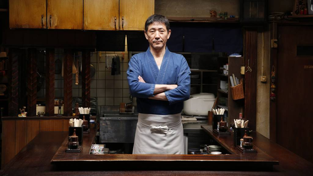 the chef from Midnight Diner inside his kitchen