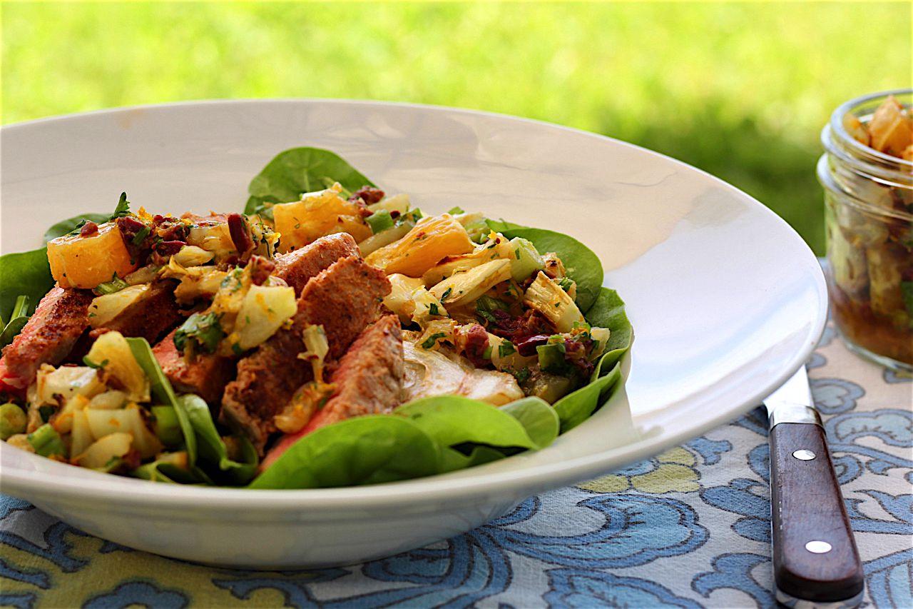 a plate of crispy tuna and greens