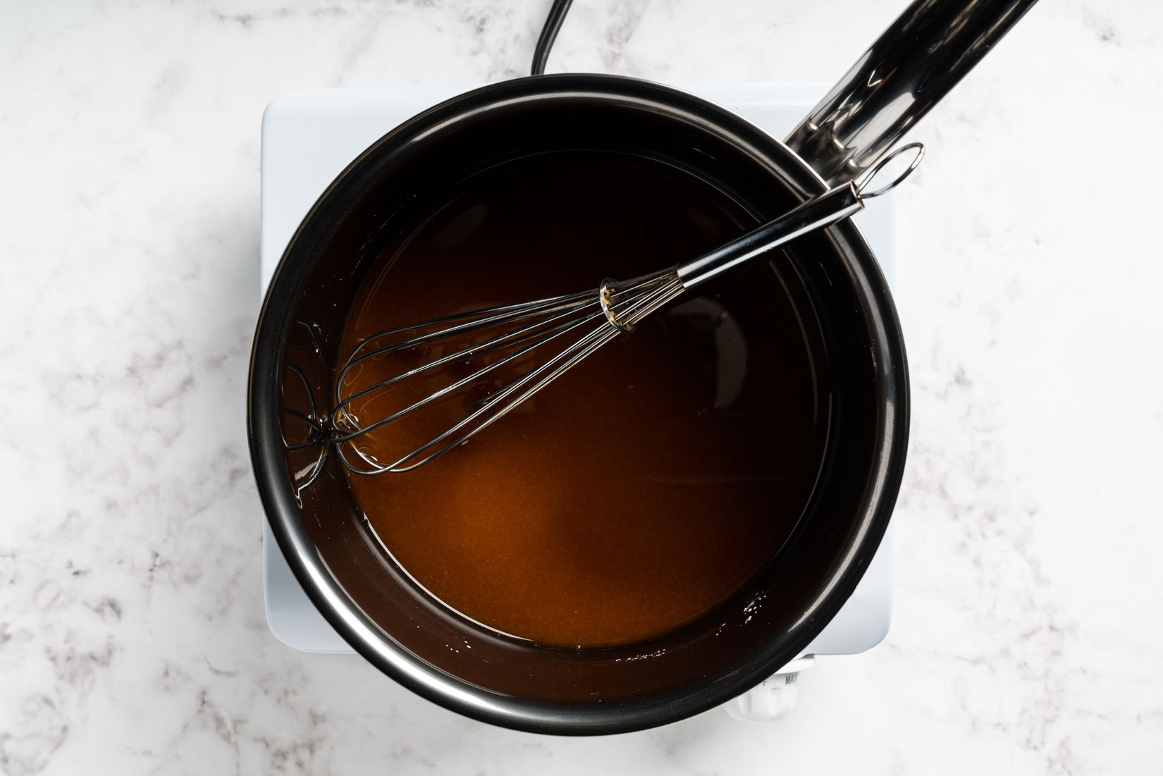 whisking the sauce