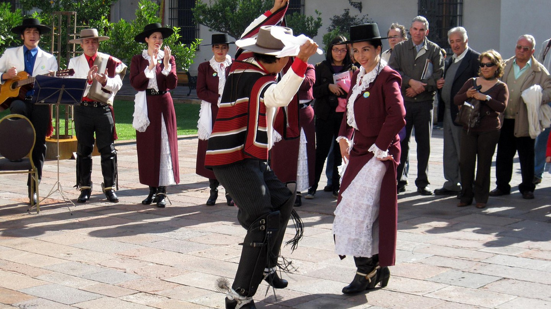 People dancing Cueca on the street