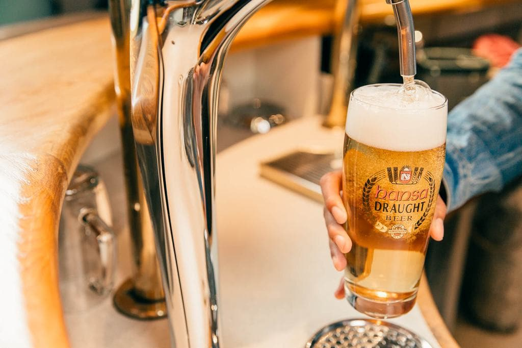 Pouring draft beer by one of Namibia's breweries
